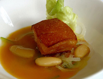 Crispy pancetta with fabada vinaigrette and itx broth