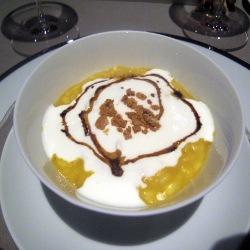 Risotto con crema de calabaza, cuajada de cabra, polvo de amaretti y balsámico