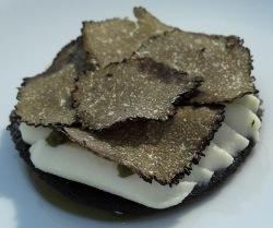Veal gelatine, sugar disc with caramelized liquorice, almond dough and black tru
