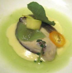 Raw Oyster, with an Oyster Leaf over Green Apple and Coriander Juice.