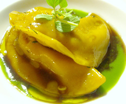 Rabbit and foie gras ravioli with wild herbs